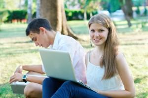 students-laptops-park
